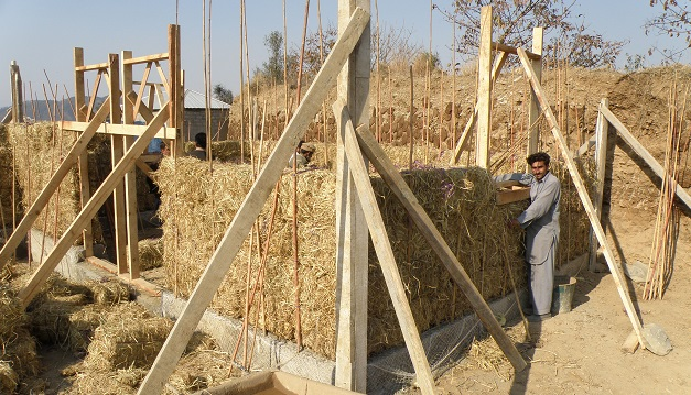 A Straw Bale House Under Construction © PAKSBAB