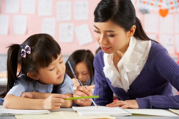 teacher student chinese working students classroom primary children helping desk send teachers parents asian reading test juan female schools exam