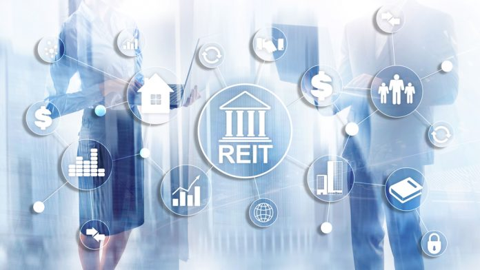 Real Estate Investment Trust REIT on double exsposure business background.