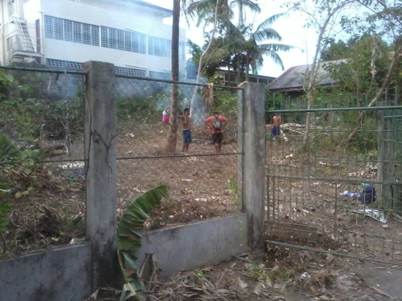 Vacant lot with fence gate improvements in primary